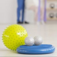 Close-up of colorful physiotherapy equipment on the floor in rehabilitation center